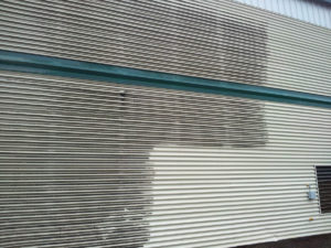 Power washing building exteriors