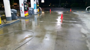 Power washing gas station concrete